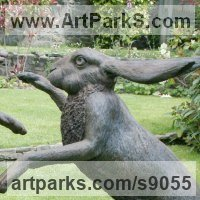 Hares and Rabbits Sculpture by sculptor artist Martin Duffy titled: 'Large Boxing Hares' in Bronze