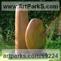 Carved Wood Sculpture by sculptor artist Nicola Beattie titled: 'Harmony (Minimalist carved Man and Woman statue)' in Black walnut