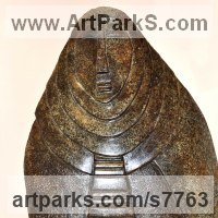 Spiritual sculpture by sculptor artist Perryn Butler titled: '11 Hildeguarde Von Bingen' in Stone carving blue granite
