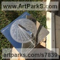 Sundials by sculptor artist Piers Nicholson titled: 'Memorial Sundial in a garden in Florida' in Stainless steel