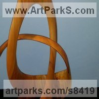 Spiral Twisted sculpture / statue / carving by sculptor artist Robert Coia titled: 'Celtic Triple Knot (Carved Fruit Wood abstract statue)' in Cherry wood