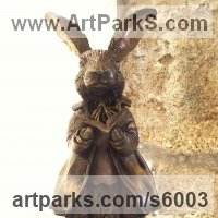 Fairies Imps Trolls Gnomes Pixies Elves Goblins Hobgoblins Leprechauns Gremlins Elfs statuettess figurines Sculpture Statues by sculptor artist Sara Ross titled: 'Storytime (Rabbit Clothed and Reading a Book sculptures)'