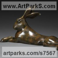 Hares and Rabbits Sculpture by sculptor artist Simon Gudgeon titled: 'Reclining Hare (Resting Lying Mad March Hare garden sculpture statue)' in Bronze