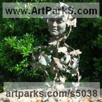 Foliage Leaves Carvings Sculpture Statues by sculptor artist Sioban Coppinger titled: 'Poets Muse Too (Bronze Girl`s Face in the Leaves sculpture statue Bust)' in Bronze, beaten and welded copper