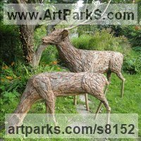Willow, Bark and moss sculpture / statue / statuette by sculptor artist Tessa Hayward titled: 'Stag and Doe (life size Deer Yard or garden statues)' in Bark copper wood