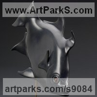 Sea Fish Sculpture by sculptor artist Tony Mayo titled: 'Angel Fish (Carved Black Stone Swimming Modern statue)' in Black pyrophyllite, carnelian, amethyst