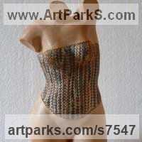Site Specific Sculpture or Statues by sculptor artist Verena Mayer-Tasch titled: 'Little Venus - Bodice (Small Girl`s Torso in Boob Tube statue)' in Terracotta