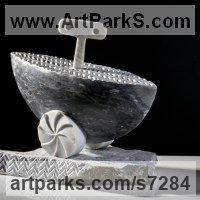Transport including Road / Rail / Air / Aircraft / Sea / Maritime by sculptor artist Verena Mayer-Tasch titled: 'Ship with Key (Carved stone marble Toy Clock Work Boat statue statuette)' in White and grey carrara marble