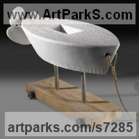 Toys Sculpture / statue / statuette / figurine by sculptor artist Verena Mayer-Tasch titled: 'Ship with Propeller (Carved stone marble Abnstract Toy Boat statue)' in White carrara marble