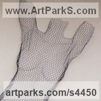 Stylized People Sculpture by sculptor artist William Ashley-Norman titled: 'female nude - (Standing Arms Up Wall Hanging Indoor Outside statue)' in Chickenwire steel mesh