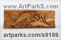 Wood Carved Wood sculpture by Adrian Arapi titled: 'Dolphins (Leaping and Sailing Ship in Maritime Panel)'