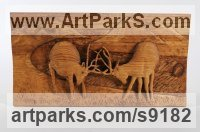 Wood Deer sculpture by Adrian Arapi titled: 'Two Deers (In Rut Fighting Carved Wood Relief panels)'