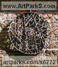 Steel Abstract Modern Contemporary Avant Garde sculpture statuettes figurines statuary both Indoor Or outside sculpture by sculptor Adrian Payne titled: 'Wall Disc (Round Circular Wall Hung Mounted Modern sculpture)'