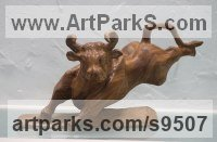 Carved wood karagach (elm tree species) Small Animal sculpture by Alexey Bykov titled: 'Fighting Bull (Charging Carved Wood little statauette)'