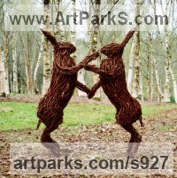 Willow, Bark and moss sculpture / statue / statuette by sculptor artist Alicia Castrillo titled: 'Boxing Hares (Outsize Mad Willow Outdoor statues)' in Steel and willow