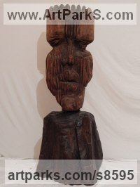 Walnut wood Primitive or Naive style Sculpture or Statuary sculpture by Andrew Minevski titled: 'Totem (Carved Wood Primitive sculpture)'