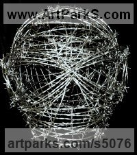 Barbed wire Human Form: Abstract sculpture by Anthony Moman titled: 'Painful Existence (Large Barbed Wire Face Mask sculptures)'
