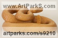 Lime Wood Reptiles Sculptures and Amphibian sculpture by Bill Prickett titled: 'Rattlesnake (Lifelike life size Carved Wood sculpture)'