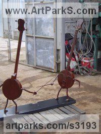 Musician and Musical Sculpture by sculptor artist Bob Fuller titled: 'Dueling Banjos (Steel Fun life size Rapiers/Swords statues)' in Steel