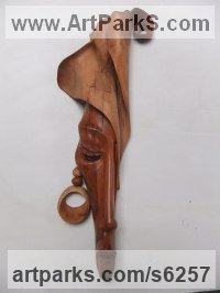 Mupapa wood (from Zambia) Wall Mounted or Wall Hanging sculpture by sculptor Charles Chambata titled: 'Women and Fashion 2 (Carved Wood Mask Wall Hanging abstract statues)'