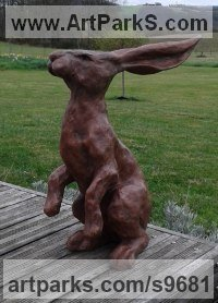 Copper resin Hares and Rabbits sculpture by Christine Close titled: 'Wind in My Hare (Hare Sniffing the Breeze statue)'