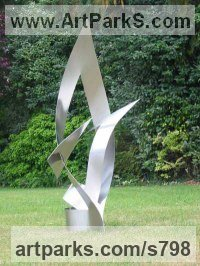 Modern Abstract Contemporary Avant Garde Sculpture or Statues or statuettes or statuary by sculptor artist Christine Fox titled: 'Times Arrow 1 (abstract Painted stainless Steel garden statue/sculpture)' in Stainless steel