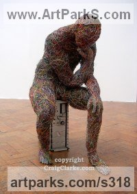 Internet and computer wire Male Men Youths Masculine sculpturettes figurines sculpture by sculptor Craig Clarke titled: 'Electric Thinker'