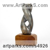 Black Soapstone on Wood Base Abstract Modern Contemporary Avant Garde sculpture statuettes figurines statuary both Indoor Or outside sculpture by sculptor Cynthia Lewis titled: 'Twist (Small Carved Soap stone Helical Spiral sculptures for sale)'