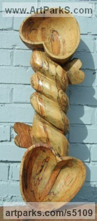 Spalted beech Celtic Knot Work and Traditional sculpture by David Gross titled: 'Lovespoons (Carved Wood Snail sculptures)'