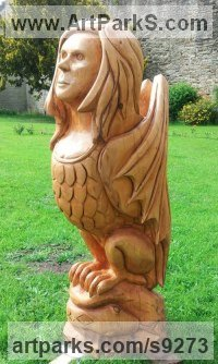 Carved cedar wood Dragons sculpture by David Gross titled: 'Siren'