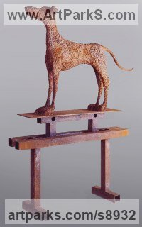 Steel Dogs sculpture by David Mayne titled: 'Dog (on trestle Standing Alert statue or sculptures)'