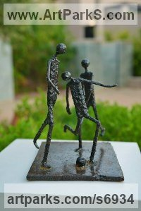 Welded mild steel Sculpture of Children by Dawn Boys-Stones titled: 'The Beautiful Game (abstract Steel Football sculpture statue statuette)'