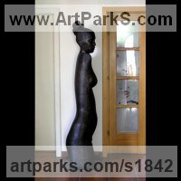Wood,Walnut Females Women Girls Ladies sculpture statuettes figurines sculpture by sculptor Doru Nuta titled: 'Morning (Carved abstract Wood nude Woman sculptures)'