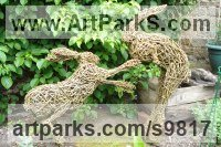 Willow, Bark and moss sculpture / statue / statuette sculpture by Emma Walker titled: '`BOXING HARES`2 (life size Willow Yard garden statues)'