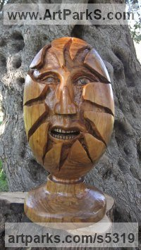 Olive wood Green Man (and Green Woman)Faces, Busts, Heads, Torsos sculpture by Eric Kempson titled: 'Hatching (Face/Egg Primitive Wood Carving sculpture)'
