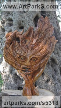 Olive wood Celtic Knot Work and Traditional sculpture by Eric Kempson titled: 'The Green Man (Traditional Wood Suspended Wall Hung statue/Carving)'