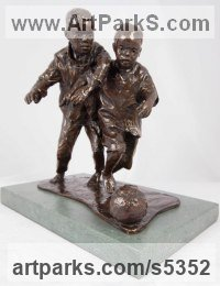 Bronze Children Child Babies Infants Toddlers Kids Sculptures Statues statuettes figurines sculpture by Graham Ibbeson titled: '2 Lads, 1 ball (Boys Playing Football Bronze statues statuettes)'