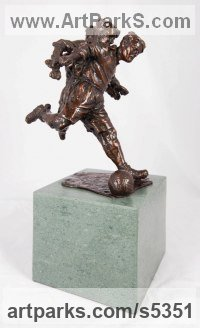 Bronze Children Child Babies Infants Toddlers Kids Sculptures Statues statuettes figurines sculpture by Graham Ibbeson titled: 'Barnsley Babe (Tommy Taylors Youth Small Boy playing Footbal statuette)'