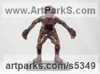 Bronze Humorous Witty Amusing Lighthearted Fun Jolly Whimsical Sculptures Statues statuettes figurines sculpture by Graham Ibbeson titled: 'Bring it on Bronze Boy Playing Football Goalkeeper'