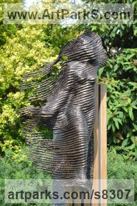 Bronze on wood Drapery sculpture Statuettes Carvings sculpture by sculptor Hans Koenen titled: 'The Phantom (Bronze female in WornRagged clothing garden statue)'