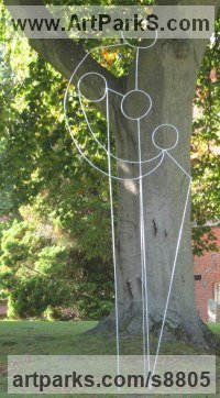 Steel Parent - Child sculpture by Henrietta Bud titled: 'Mother Baby and Child (contemporary abstract Wire statue)'