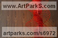 Aluminium Geometric sculpture statuary statuettes. Usually Abstract Contemporary Modern work sculpture by sculptor Ivan Black titled: 'Red Serpentine (Suspended Coloured Red Helix sculptures)'