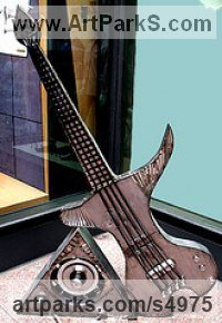 Recycled Steel Musician and Musical sculpture by sculptor Jaak Kindberg titled: 'Bass Station (Modern Guitar Musical statue/sculpture)'
