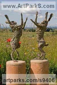 Bronze, hamstone base Hares and Rabbits sculpture by Jan Sweeney titled: 'Dancer and Spar'
