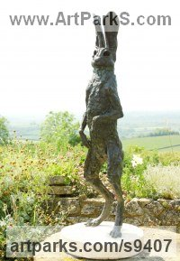 Bronze hamstone base Hares and Rabbits sculpture by Jan Sweeney titled: 'Look'