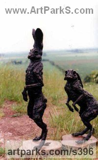 Bronze Hares and Rabbits sculpture by Jan Sweeney titled: 'Look and Off (bronze Mad March Hares Poised statues)'