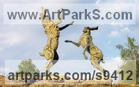 Bronze ham stone base Hares and Rabbits sculpture by Jan Sweeney titled: 'Spar and Buck'