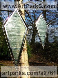 Suspended Sculpture or Statues or Statuettes by sculptor artist Jane Bohane titled: 'Incognito (abstract Contemporary Coloured Glass garden Panel statues)' in Stainless steel. stained glass