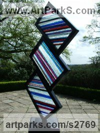 Square Rectangular Cube shaped Abstract sculpture statue by sculptor artist Jane Bohane titled: 'Staccato III (Stained Glass Rectangles garden sculpture)' in Powdered steel and glass