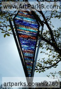 Mirrored stainless steel. stained glass Glass or Acrylic Transparant sculpture by sculptor Jane Bohane titled: 'Vann (abstract Coloured Kite Shaped Glass Outdoor statue)'